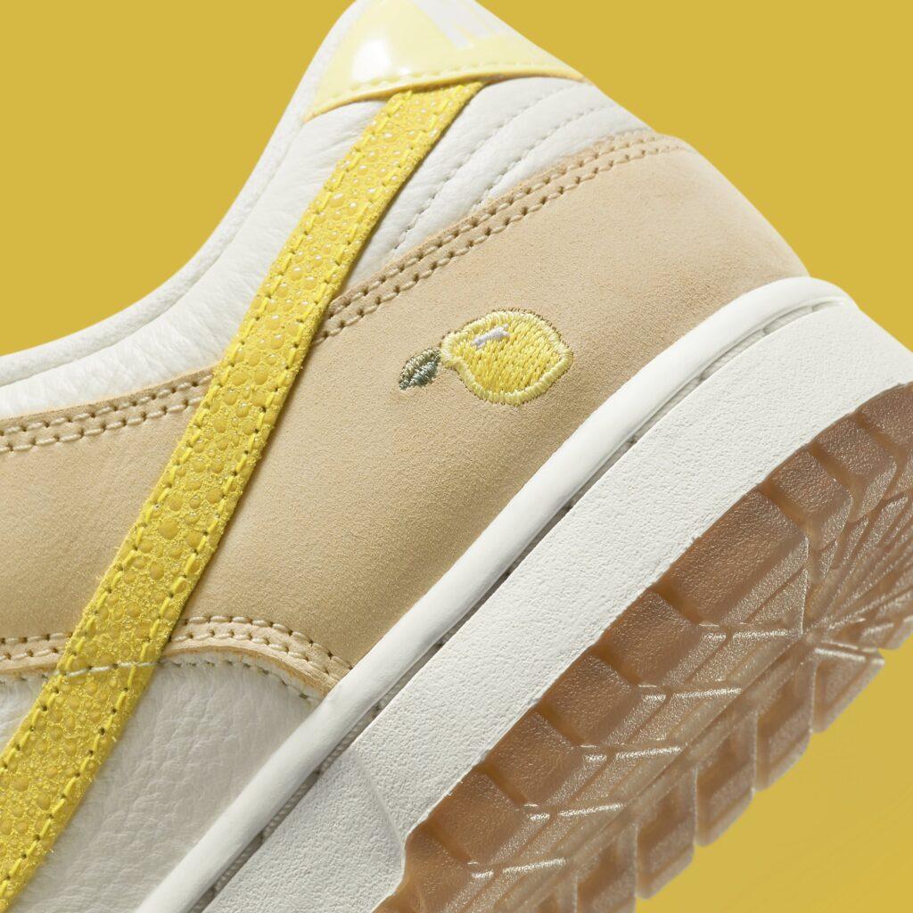 nike-dunk-low-lemon-drop-dj6902-700-heel (1)